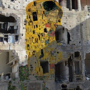"Gustav Klimt's ""The Kiss"" has been reproduced on a devastated building in Syria by artist Tammam Azzam"